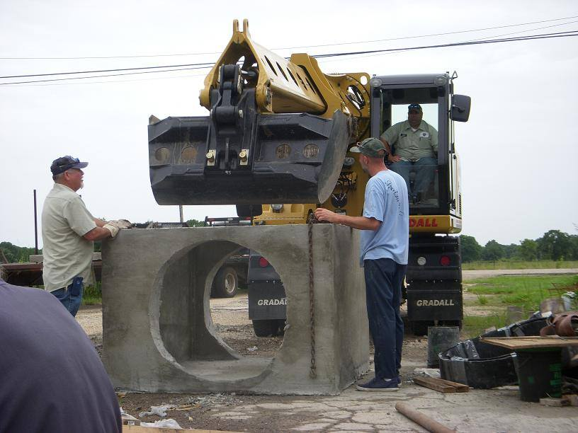 The precast concrete catch basin for Ascension Parish arrives on site ready to install